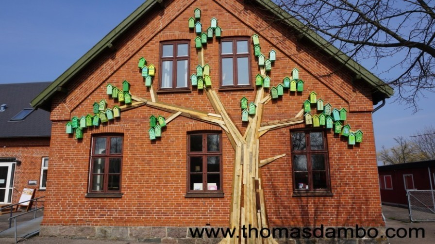 Local kids helped paint these 60 birdhouses in Copenhagen.
